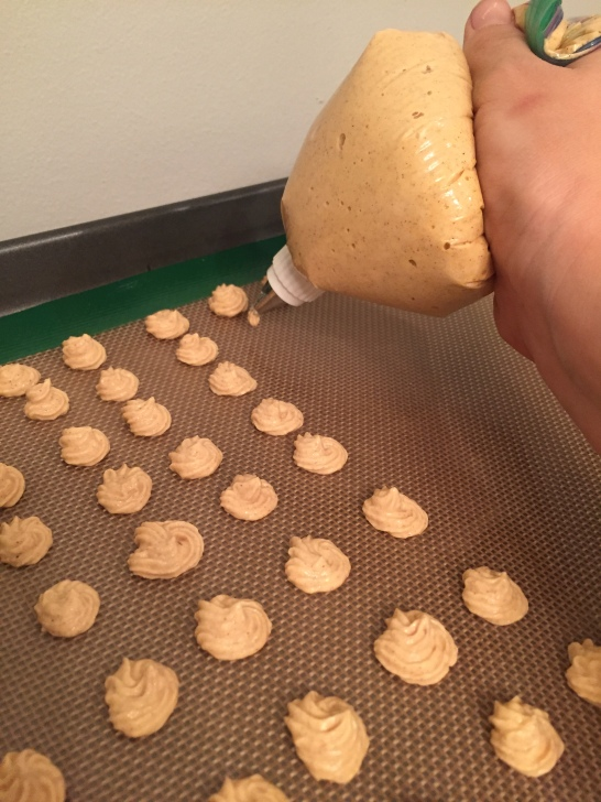 place mixture into piping bag and pipe dime-sized treats onto lined baking sheet